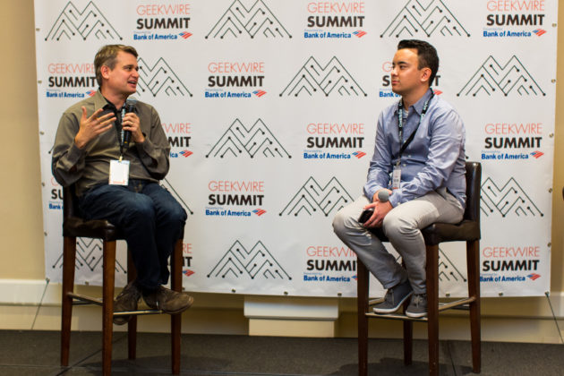 Pioneer Square Labs co-founder Greg Gottesman (left) interviewed by GeekWire reporter Taylor Soper at the 2016 GeekWire Summit. Photo by Dan DeLong/GeekWire.