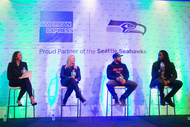 American Express Vice President Danielle Wallis moderates a discussion on 'Creating A Movement: Rallying the Community Behind Your Brand' with panelists Amy Sprangers, Vice President of Corporate Partnerships and Suites for the Seattle Seahawks; James Snyder, owner of Sams Tavern; and Richard Sherman, player for the Seattle Seahawks. (Photo by Mat Hayward/Getty Images for American Express)