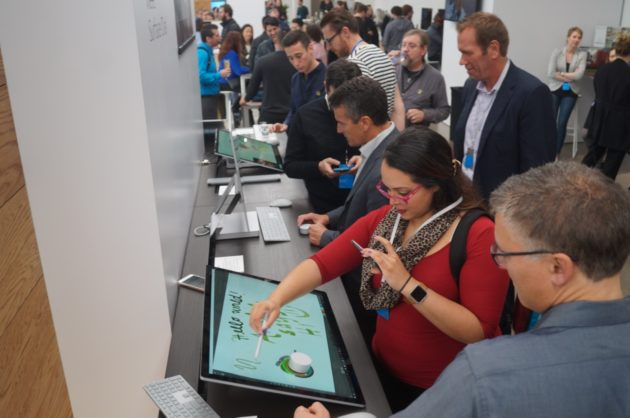Everyone wanted to test out Surface Studio and its accessories. GeekWire Photo / Nat Levy