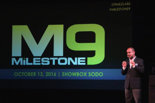 9MileLabs co-founder Sanjay Puri speaks at Demo Day on Thursday in Seattle. (GeekWire photos)
