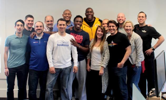 The ShotTracker team with NBA Hall of Famer Magic Johnson (center, yellow shirt). Photo via ShotTracker.