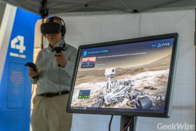 Alan Boyle explores the Mars Curiousity Rover in VR at the Museum of Flight (Photo by GeekWire/Kevin Lisota)