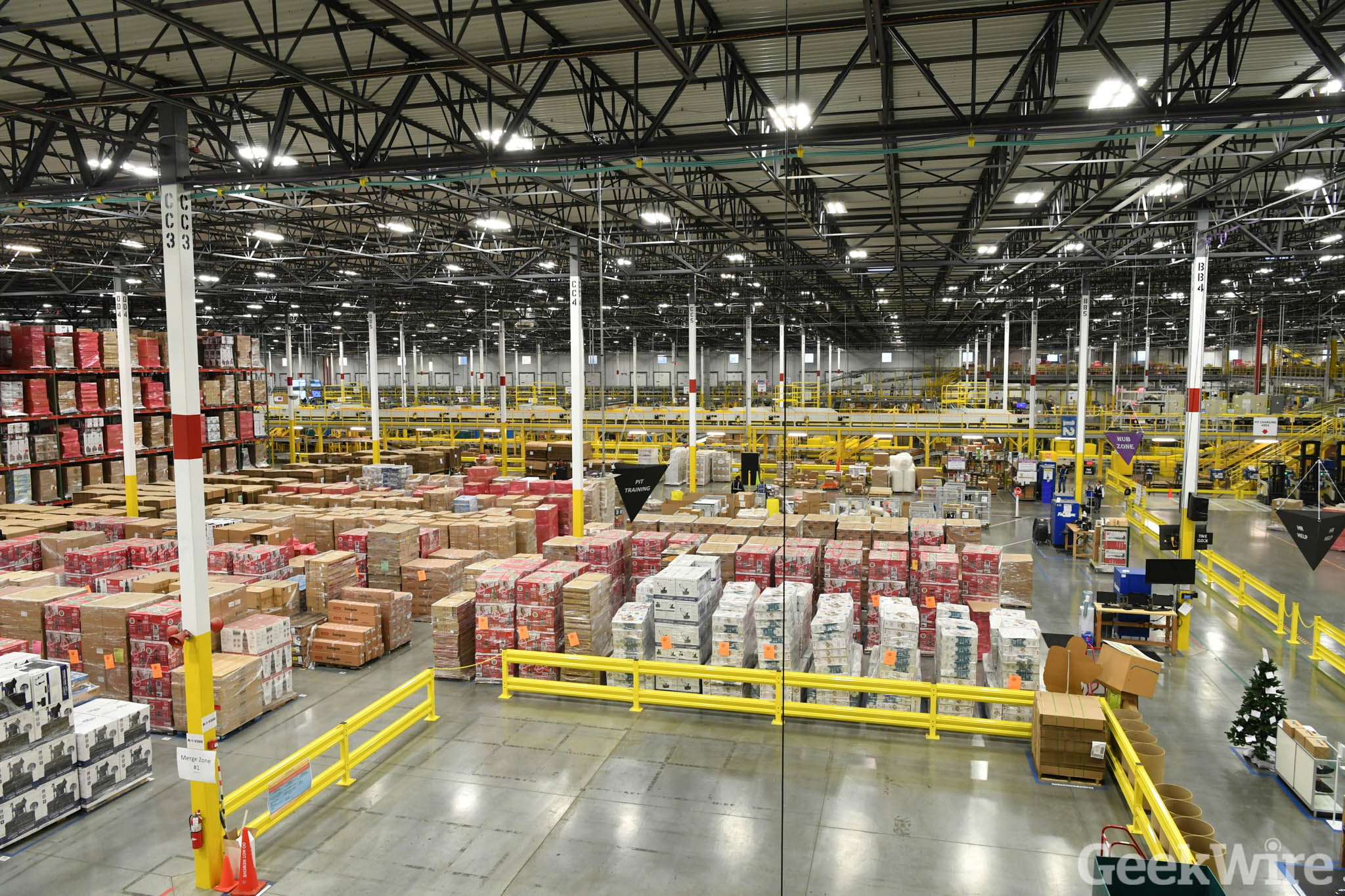 Inside Look How Amazon S Robots Help Pick Pack And Ship