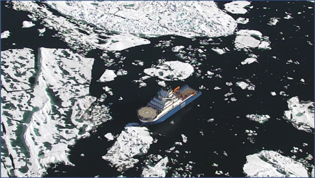 Flexrotor looks down on her base, an anchor handling tug supply vessel, surrounded by ice in the Chukchi Sea.