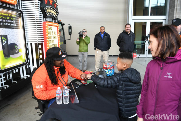 Marshawn Lynch fist bumps a young Beast Mode fan