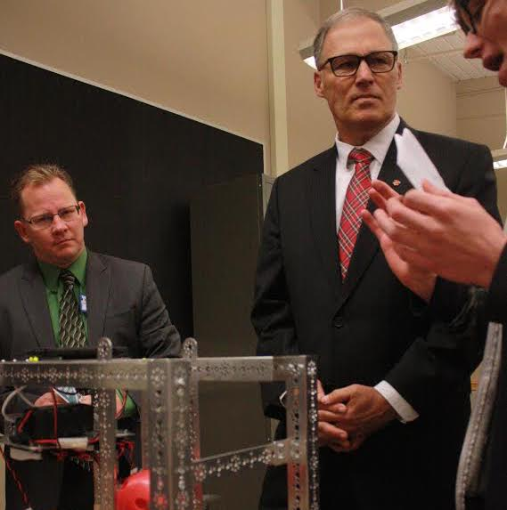 Gov. Jay Inslee, center, gets a demo at Tumwater High School as incoming Superintendent of Public Instruction Chris Reykdal looks on. (John Stang Photo)