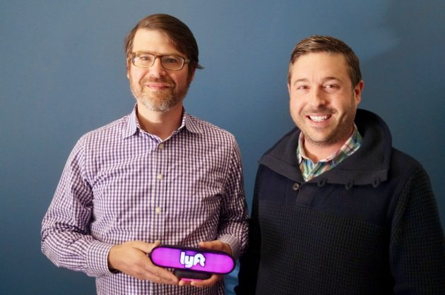 Igor Institute co-founder and VP of Engineering Sean Murphy (left) and co-founder and CEO Aren Kaser (right) with the new Lyft Amp device. (GeekWire Photo / Todd Bishop)
