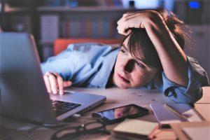 Sleep-deprived laptop user