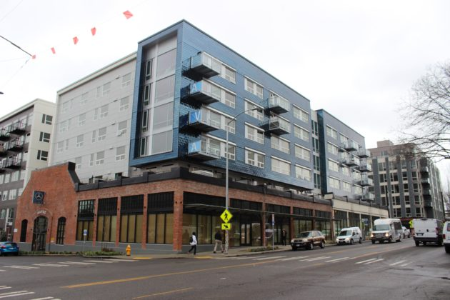 Is Amazon Building A Brick And Mortar Store On The First Floor Of This Capitol  Hill Apartment Complex At 600 E Pike? (GeekWire Photo/Taylor Soper)