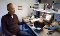 Shane Chen of Inventist at his workbench with the Solowheel Iota prototype