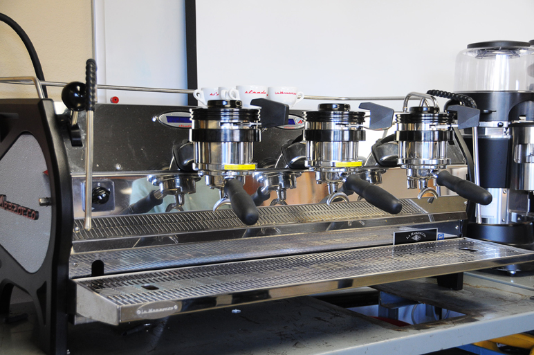 The Strada is another notable La Marzocco machine. Where the Linea Classic is hailed for its durability and classic design, the Strada is a highly technical machine. The Ballard location offers barista training courses for its use.