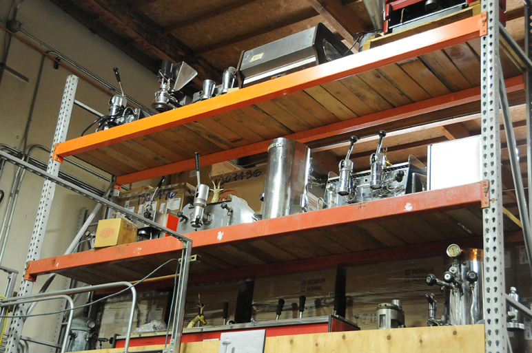 Bakke's collection of antique espresso machines hangs over the warehouse.
