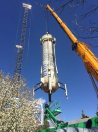 Blue Origin New Shepard booster on crane