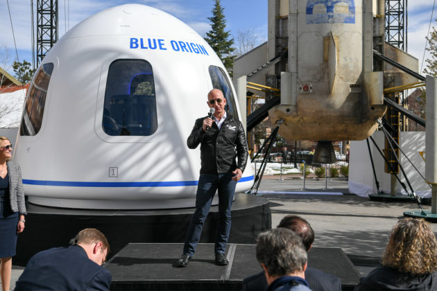 Jeff Bezos with New Shepard booster and capsule mock-up