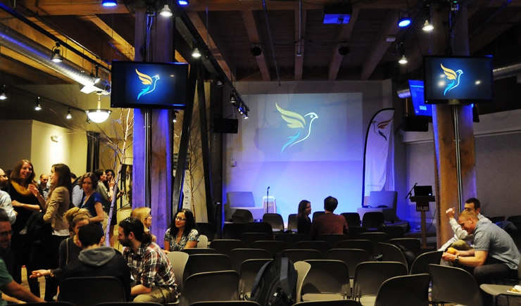 """Audience members talk with the """"fledglings"""" after their presentations at the Hub Seattle.  Host Luni Libes said the location was special because it's also where the ten-week Fledge course took place."""