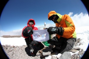 Googlers Dan Fredinburg and Michele Battelli on the summit of Aconcagua. (Photo by Jamie McGuinness from http://www.project-himalaya.com)