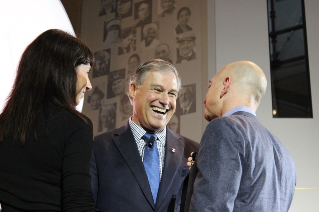 Washington Gov. Jay Inslee speaks with Amazon founder Jeff Bezos and his wife Mackenzie.
