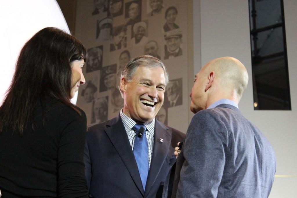 Washington Gov. Jay Inslee speaks with Amazon founder Jeff Bezos and his wife Mackenzie.