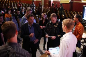 High-schoolers who developed the community-based app speak with Portland Police Chief Mike Reese (center).