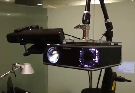 Microsoft's current IllumiRoom prototype: A wide field of view projector paired with Kinect.