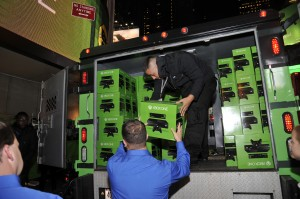 Armored trucks delivering the first Xbox One consoles for sale in the US arrive at Best Buy Theater in Times Square for the launch of Xbox One on Thursday, November 21, 2013. (Photo by Charles Sykes/Invision for Microsoft/AP Images)