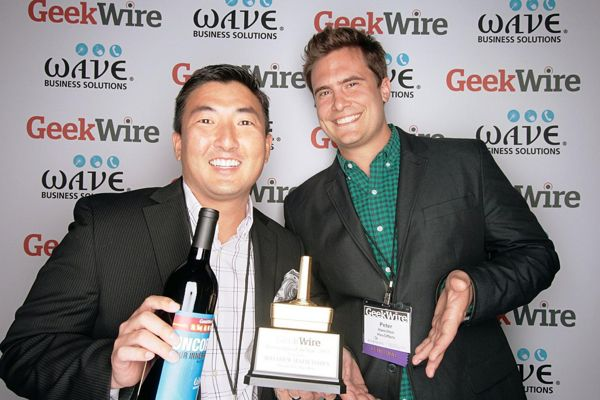 """Matthew Matsudaira of Adorii accepts the award for """"Bootstrapper of the Year"""" from category sponsor Peter Hamilton of Has Offers, last year's champ."""