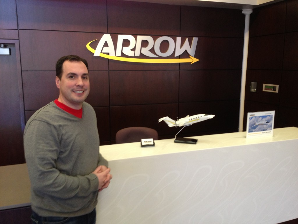 Arrow founder Russell Belden at the ticket counter at Boeing Field