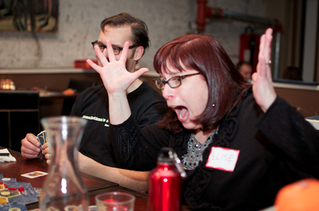 Elise Shapiro celebrates as Rob McGarty looks on at  a GeekWire Game Night. (Annie Laurie Malarkey photo)