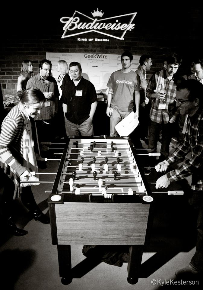 Attendees compete in foosball at the GeekWire Bash. (Kyle Kesterson photo).