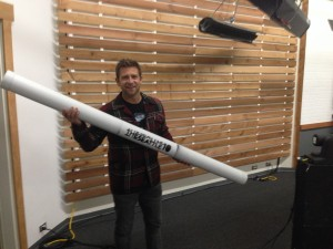 CreativeLive's Chase Jarvis holding the cocktail napkin tube.