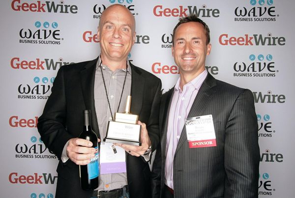 "New Amazon.com employee Charlie Kindel, winner of ""Hire of the Year,"" with category sponsor Bryan Schielke, VP of Summit Group."
