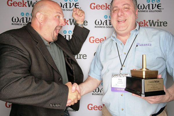 """Innovation of the Year"" category sponsor Geoff Deane, the vice president of Intellectual Ventures Labs, celebrates with Puzzazz founder Roy Leban, who won for his handwriting recognition technology, TouchWrite."