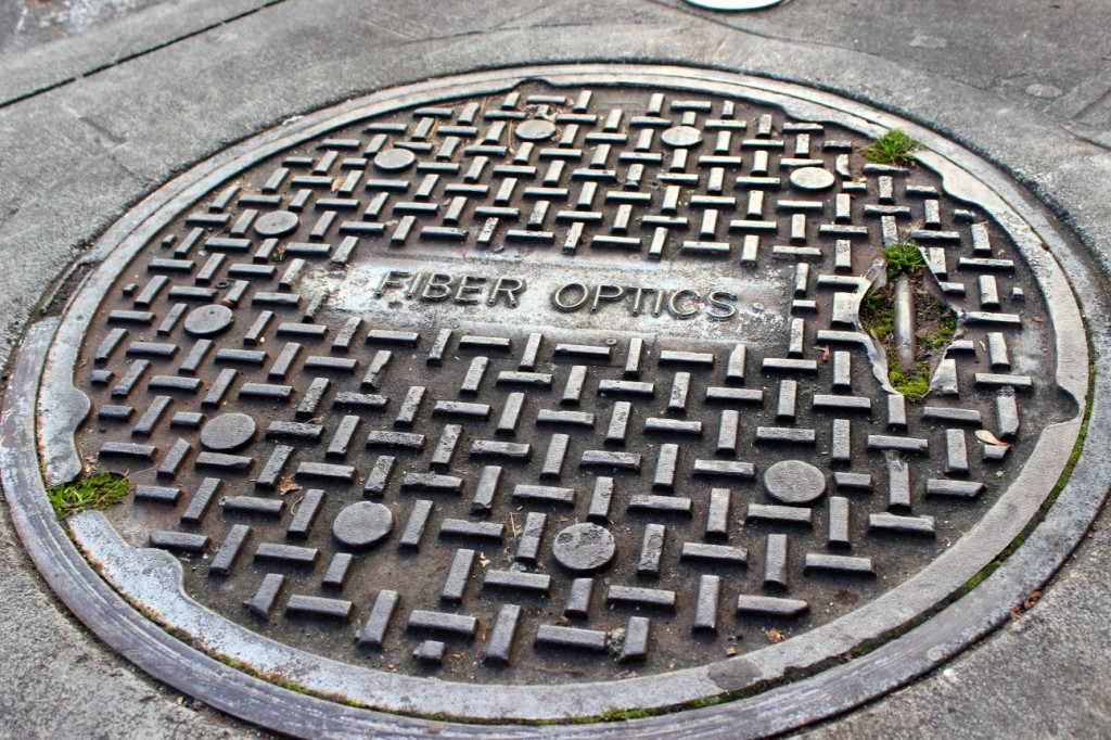 A manhole cover in Seattle's University District marks one of the access points for the Seattle's existing fiber-optic network, which was to be leveraged by Gigabit Squared to provide high-speed Internet to homes and businesses in the city. That partnership fell apart in December.