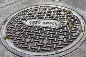A manhole cover in Seattle's University District marks one of the access points for the Seattle's existing fiber-optic network.