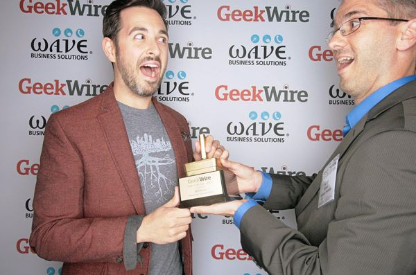 "SEOmoz CEO Rand Fishkin, winner of the ""Perk of the Year"" award, with category sponsor Greg Bryan of Kibble & Prentice."