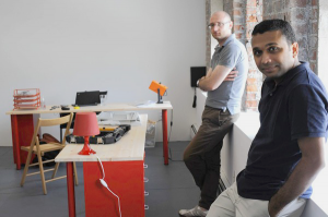 Simple founders Joshua Reich (grey shirt) and Shamir Karkal in their office in Brooklyn during the summer of 2010.