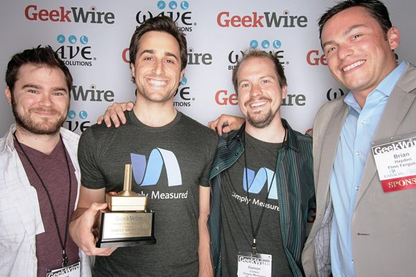 Simply Measured founders Aviel Ginzburg, Adam Schoenfeld and Damon Cortesi with Startup of the Year sponsor Brian Hayden of Flinn Ferguson Corporate Real Estate.