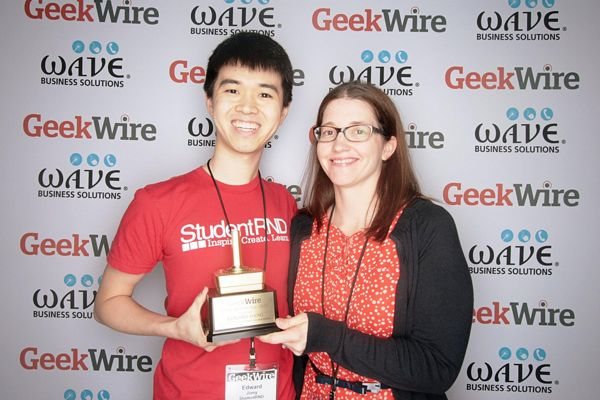 "Edward Jiang of StudentRND, winner of the ""Do-Gooder of the Year"" award, with category sponsor Dr. Rebecca Gardner of Seattle Children's Research Institute."