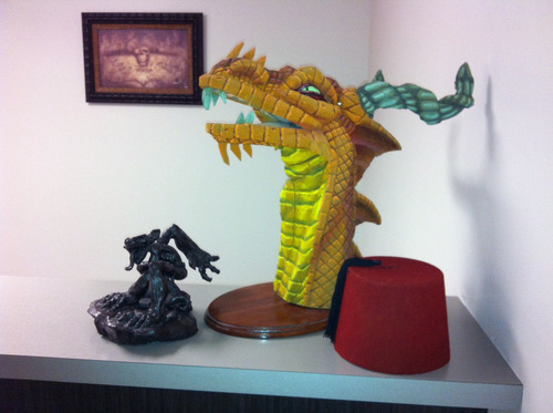 A nice dragon head and a fez sit in the WildTangent Studios office in Seattle.
