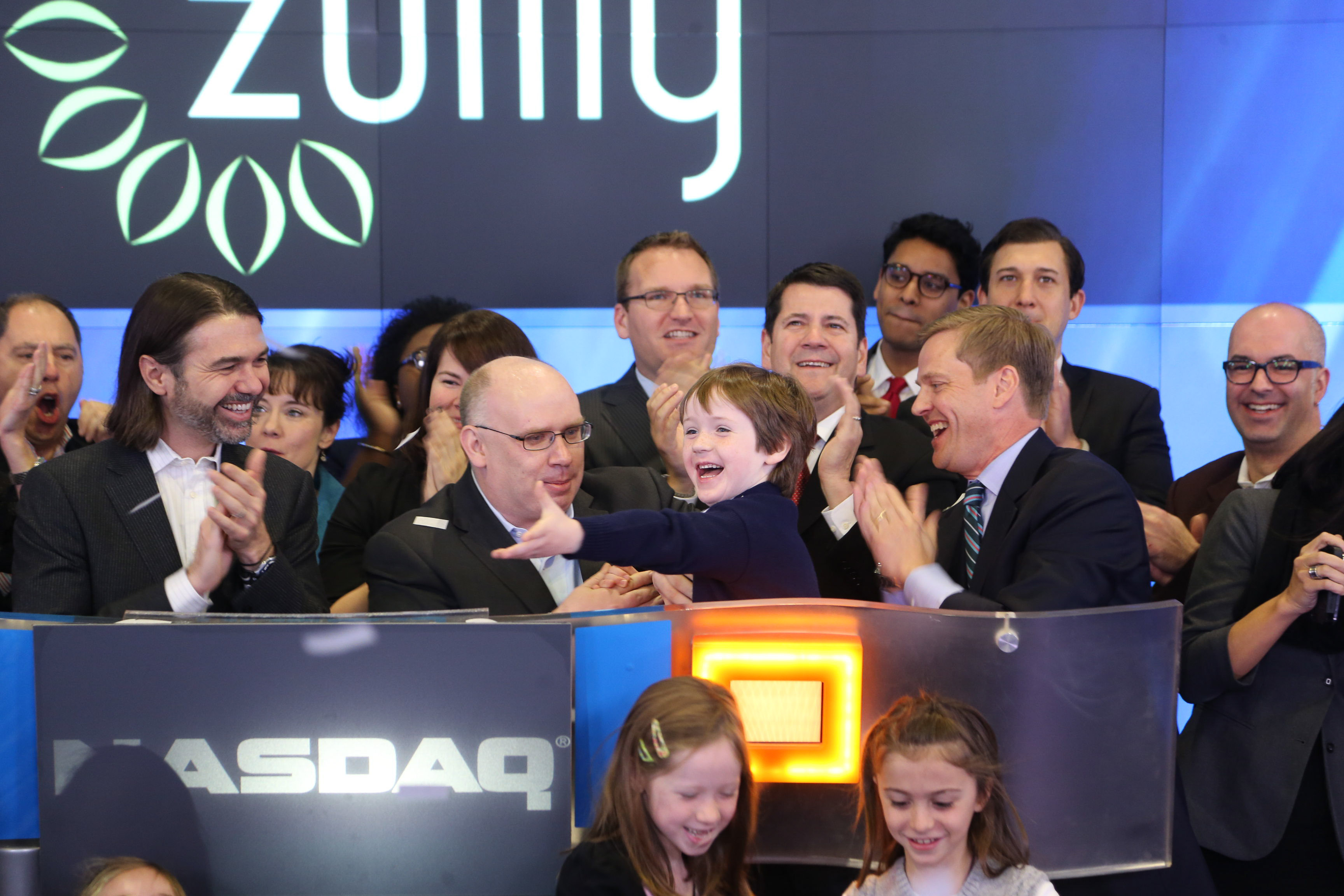 Photo of the day 5 year old son of darrell cavens introduces darrell cavens of zulily with his son and early employees opening trading on nasdaq this morning buycottarizona Image collections