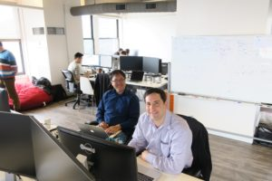 (L to R): Derek Tan, director of engineer, and Rick Negrin, director of product management, at work in MemSQL's new Seattle office.