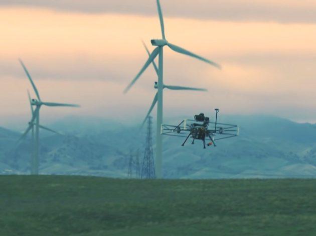 Drone inspecting wind turbines