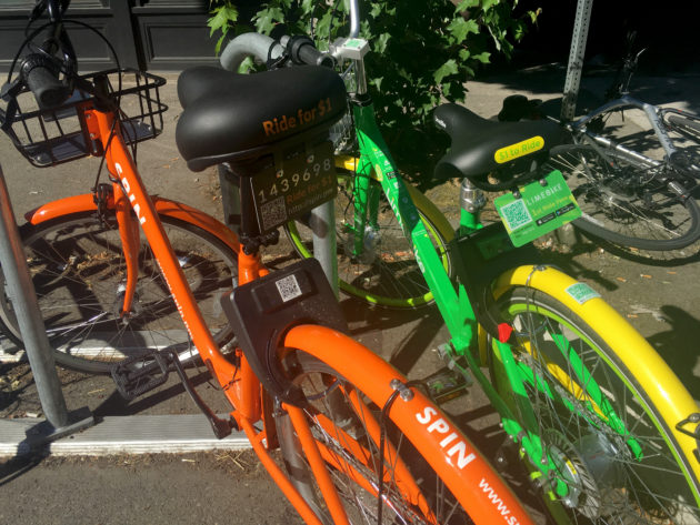 Bike-sharing services Spin and LimeBike let riders use bicycles without smartphone or credit card
