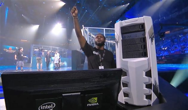 a security staff member at the international dota 2 championships holds up a plug in usb stick for an ai bot programmed to play esports