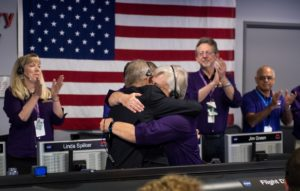 Hugs at JPL mission control over Cassini