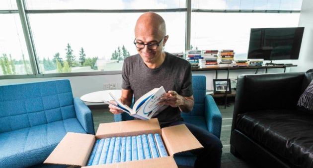 """Microsoft CEO unboxes copies of his book """"Hit Refresh,"""" set for release  Sept. 26. (LinkedIn Photo)"""