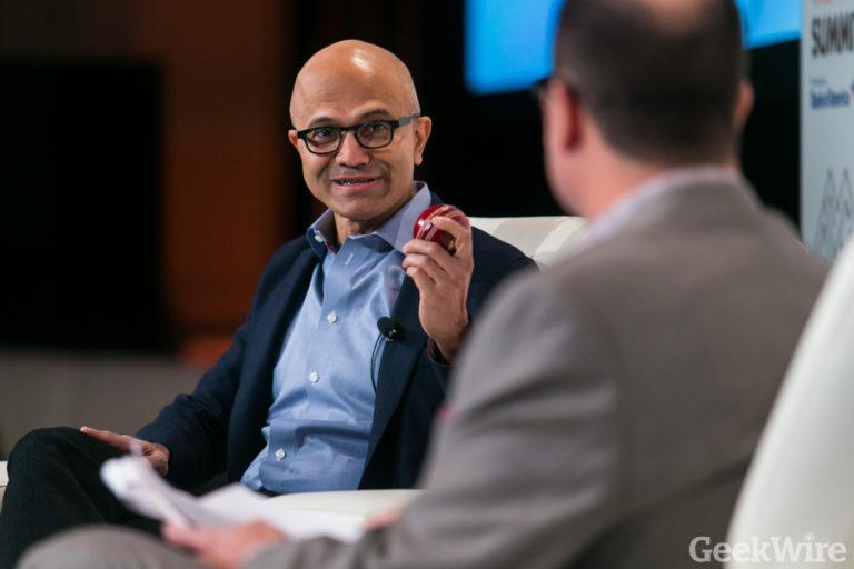 Microsoft CEO Satya Nadella holds a Kookaburra cricket ball