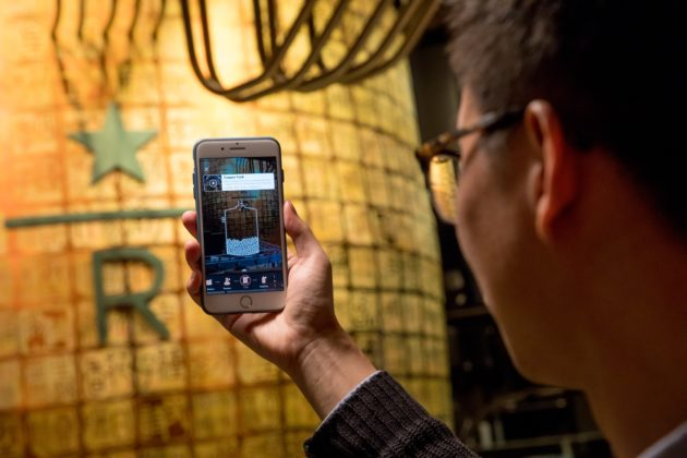 An augmented reality app is used in the new Starbucks Roastery in Shanghai China