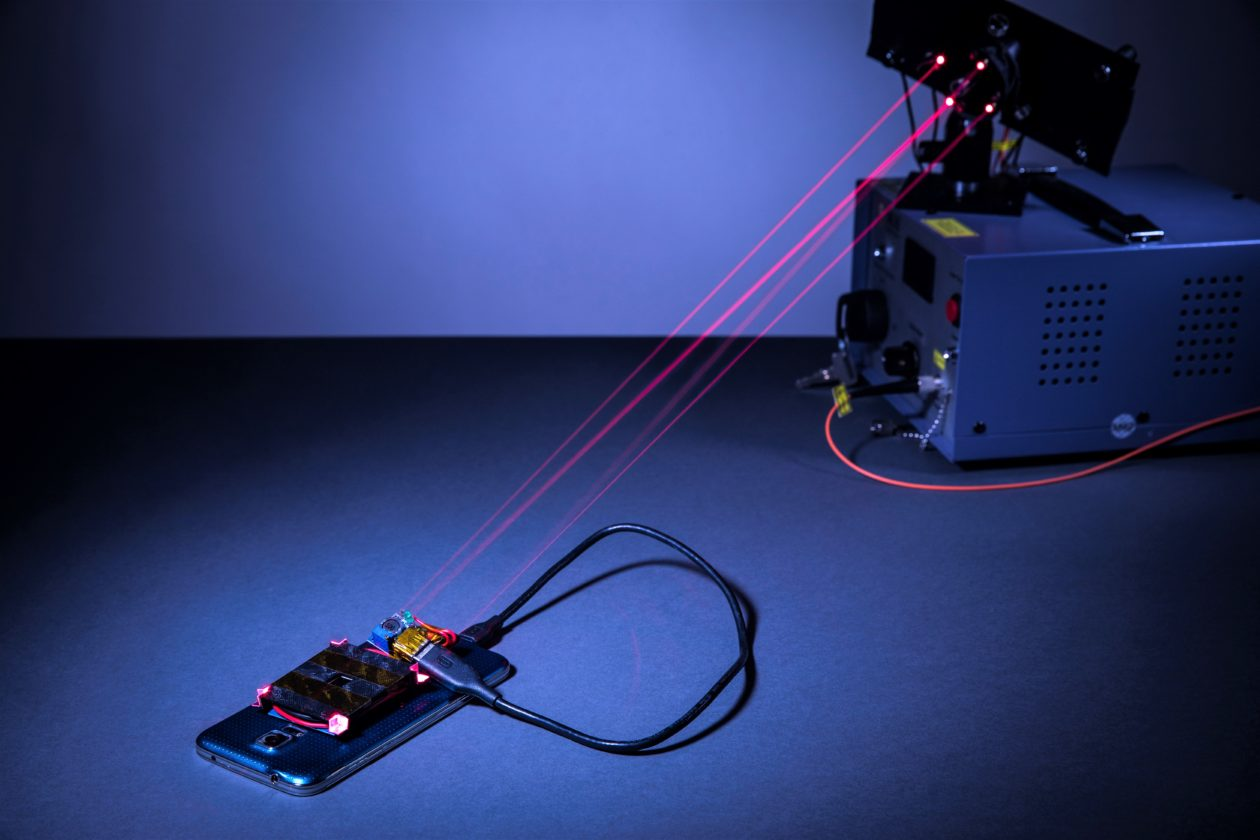Lasers charging smartphone