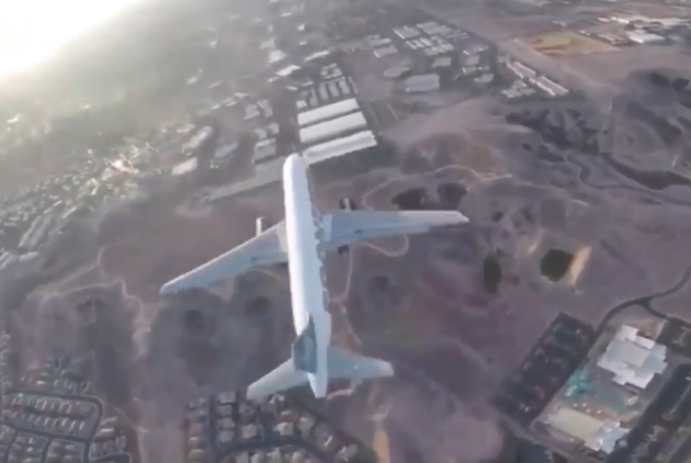 Drone captures itself flying within feet of landing airplane